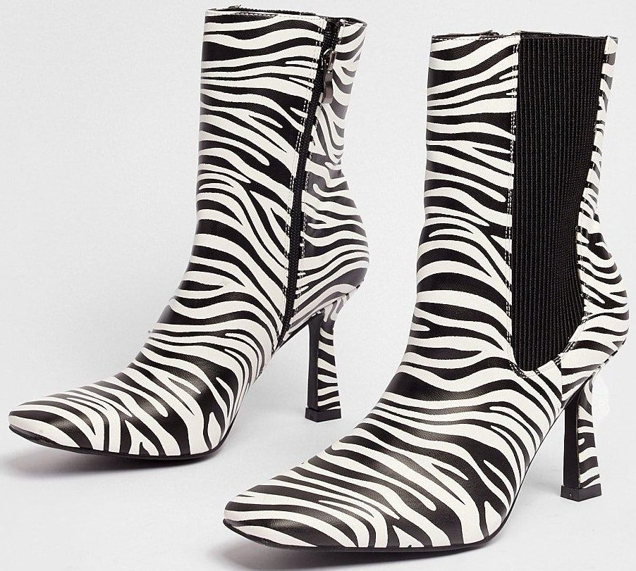 These boots come in faux leather and feature a square toe, flat sole, high ankle. stiletto heel, zebra print throughout, ribbed, elastic goring at sides, and inside zip closure