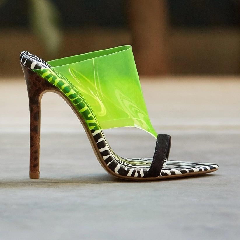 A zebra print slip-on stiletto-heeled sandal with a transparent strap detail