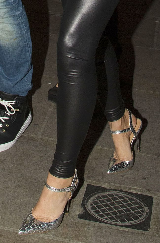 Katie Price teams her shiny leggings with ankle-strap pumps in 2013