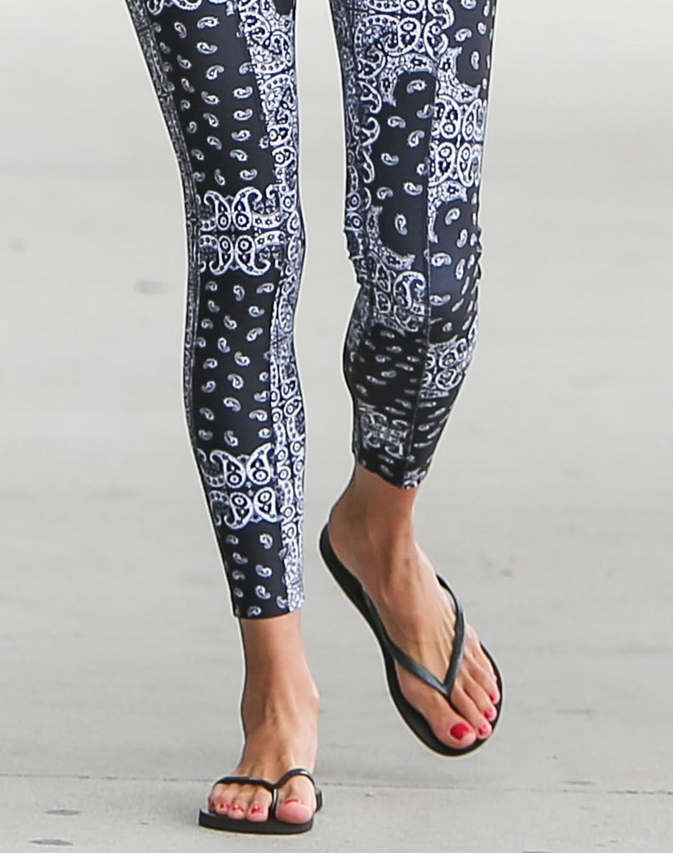 Alessandra Ambrosio pictured wearing flip flops with printed leggings on June 19, 2020