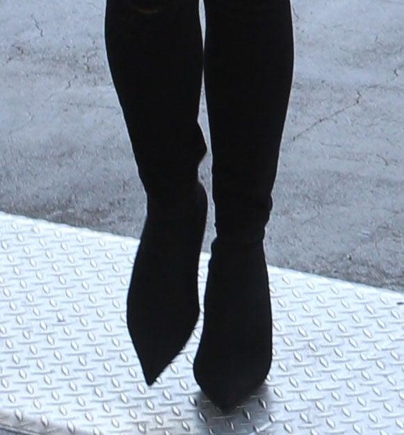 Chrissy Teigen wearing sock boots with black pants in 2017