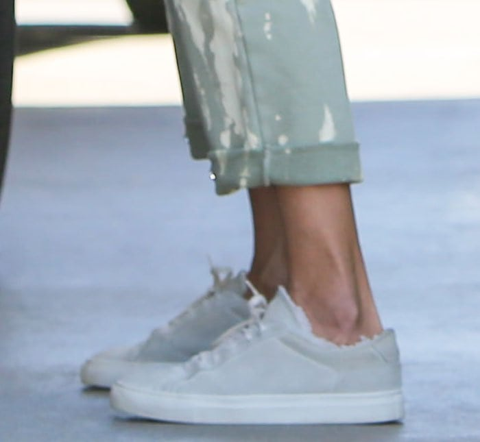 Alessandra Ambrosio wears her favorite Common Projects retro low shearling-lined sneakers
