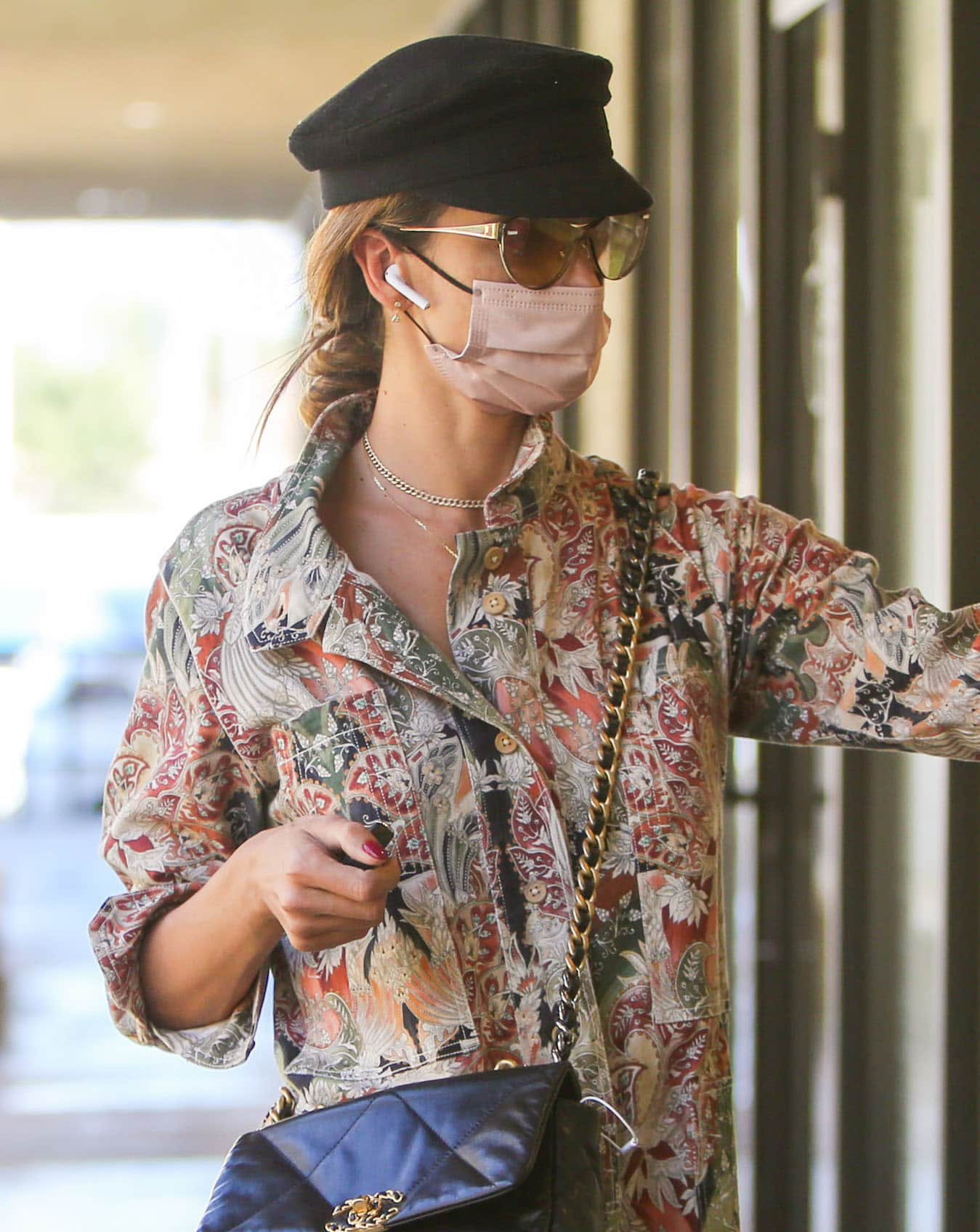 Alessandra Ambrosio looks chic with her braided ponytail under a black Breton cap