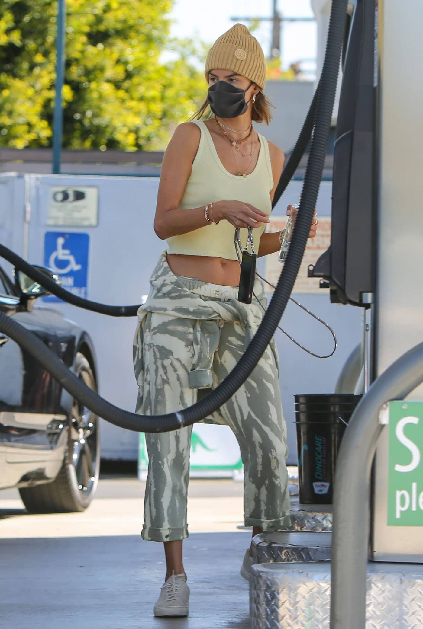 Alessandra Ambrosio pumping up her own gas in Brentwood, Los Angeles on March 18, 2021