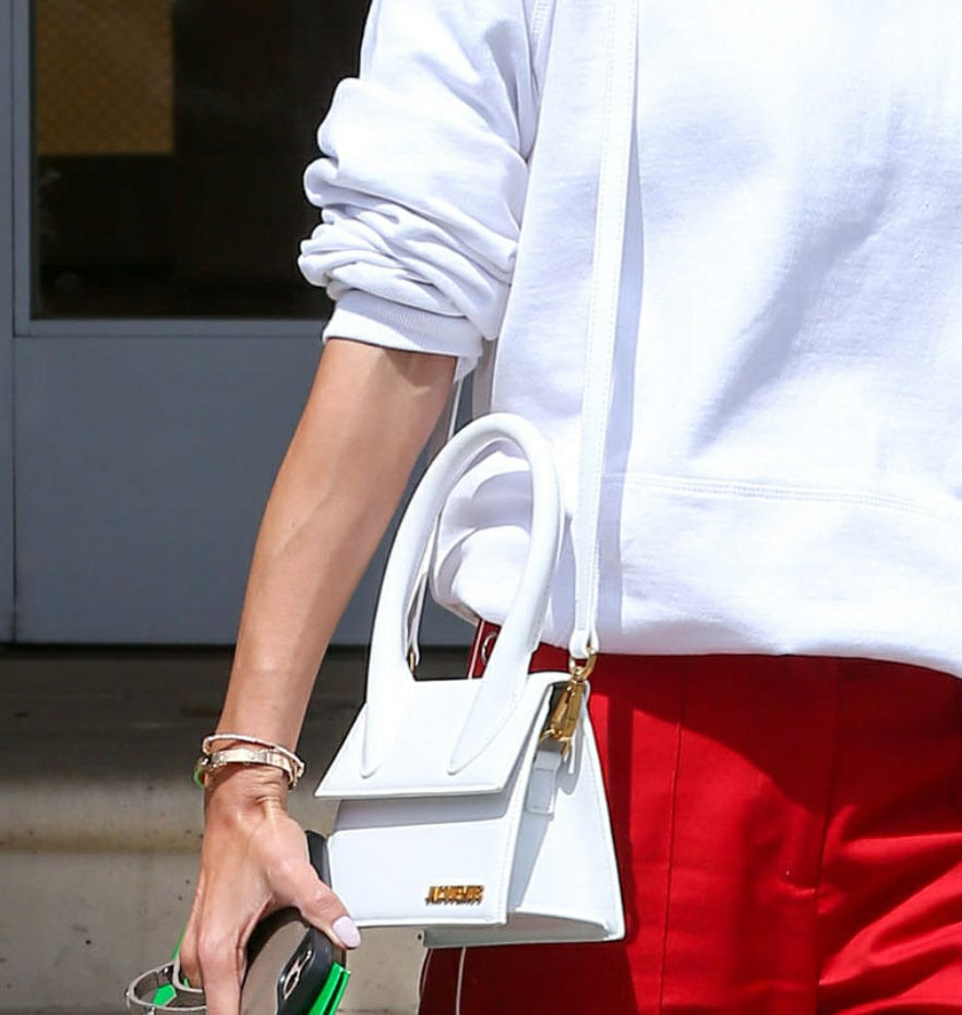 Alessandra Ambrosio carries a white Jacquemus Le Grand Chiquito leather shoulder bag