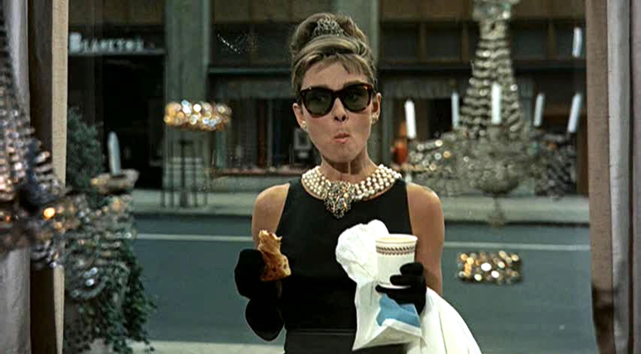 Iconic black dress designed by Hubert de Givenchy and worn by Audrey Hepburn in the opening of the 1961 romantic comedy film Breakfast at Tiffany's