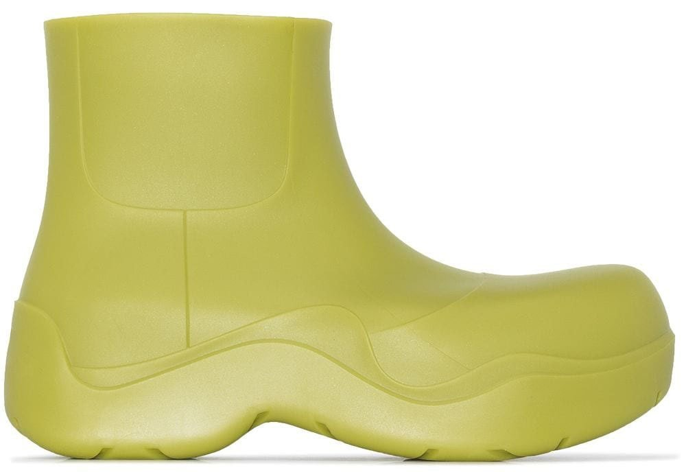 Turn heads in the Bottega Veneta BV Puddle ankle boots, featuring a seamless rubber construction with chunky soles