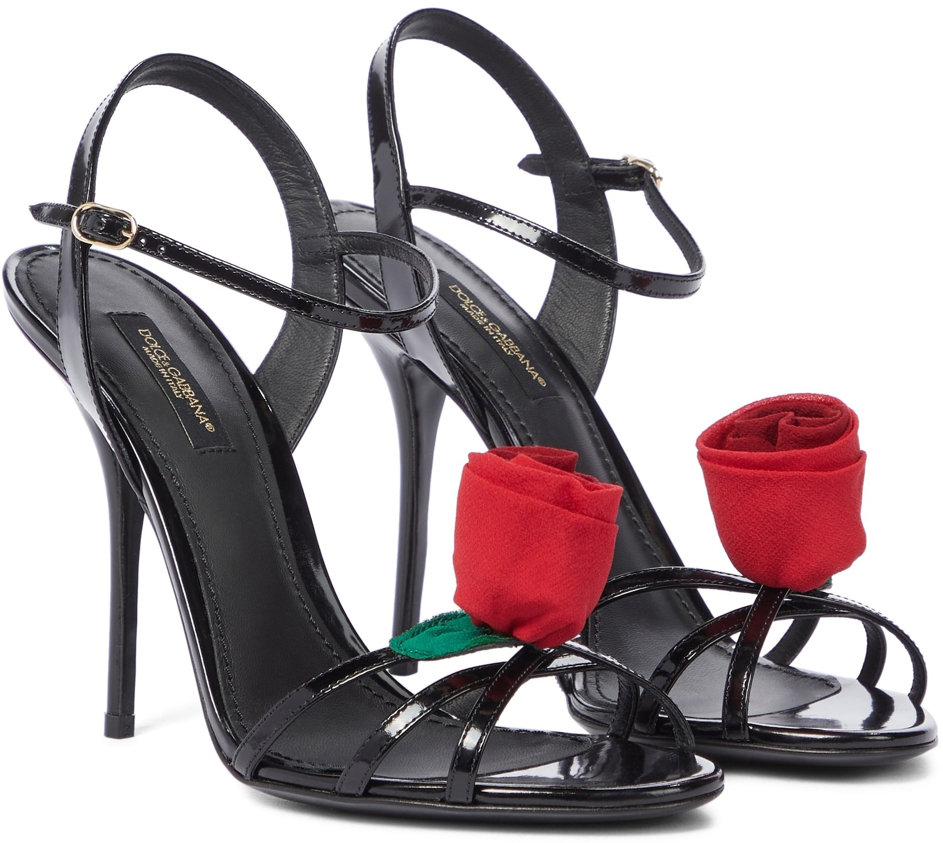 These black Keira sandals from Dolce & Gabbana are trimmed with rose embellishments for a touch of romance