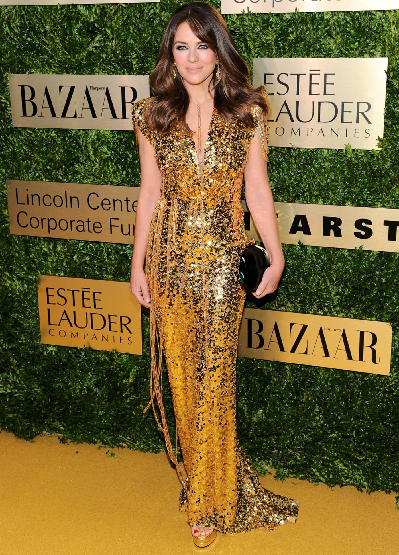 Elizabeth Hurley attends the Lincoln Center Corporate Fashion Gala in a glamorous gold-sequin dress