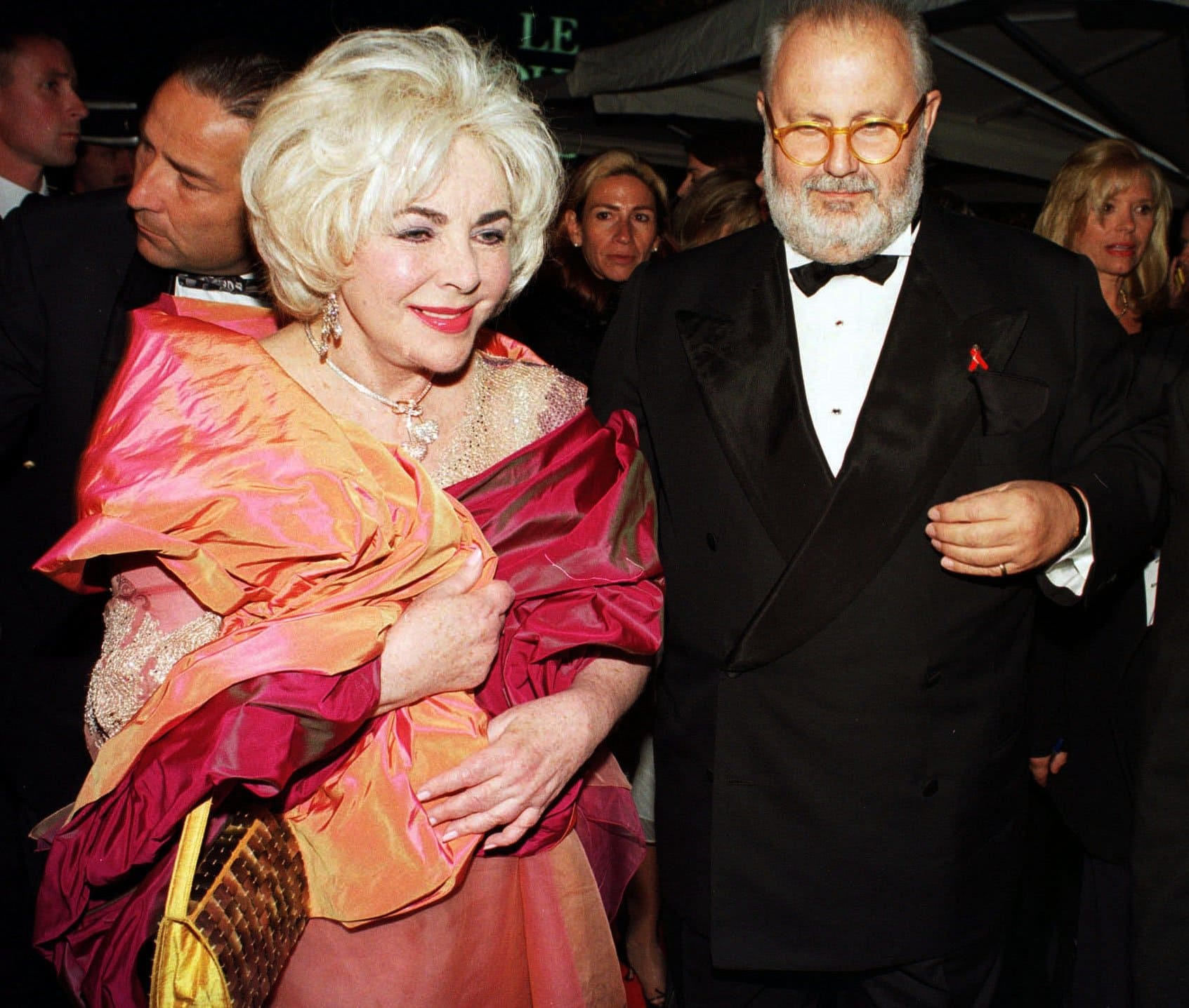 Italian fashion designer Gianfranco Ferré and Dame Elizabeth Rosemond Taylor DBE attend the amfAR Gala Cannes in 1999