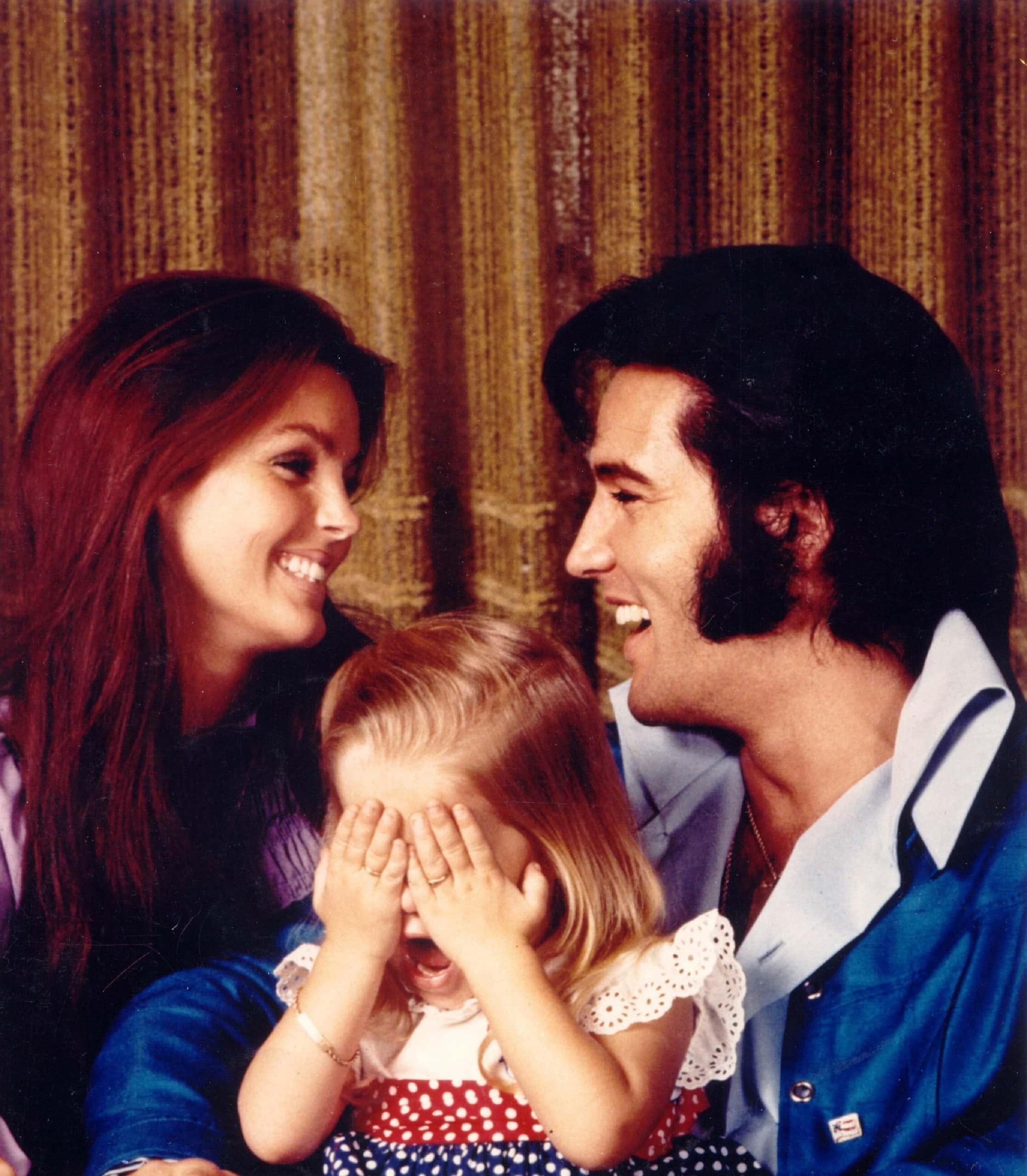Elvis Presley, Priscilla Presley, and their daughter Lisa Marie Presley in 1971