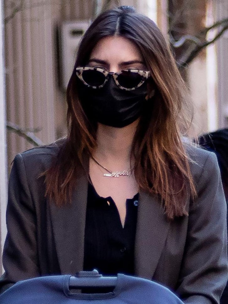 """Emily Ratajkowski wears a pair of Eleventh Hour sunnies and a personalized gold necklace with her son's name """"Sylvester"""""""