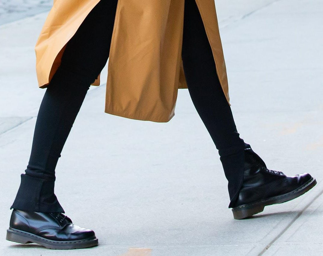 Gigi Hadid teams her coat and leggings with Dr. Martens 1460 boots