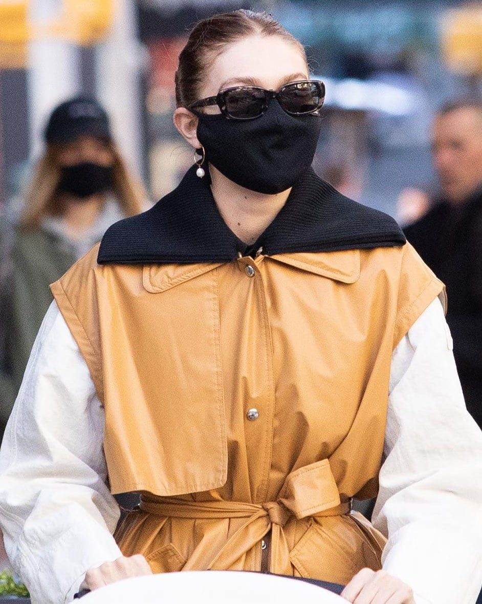 Gigi Hadid accessorizes with Linjer and The Last Line earrings and Krewe sunglasses