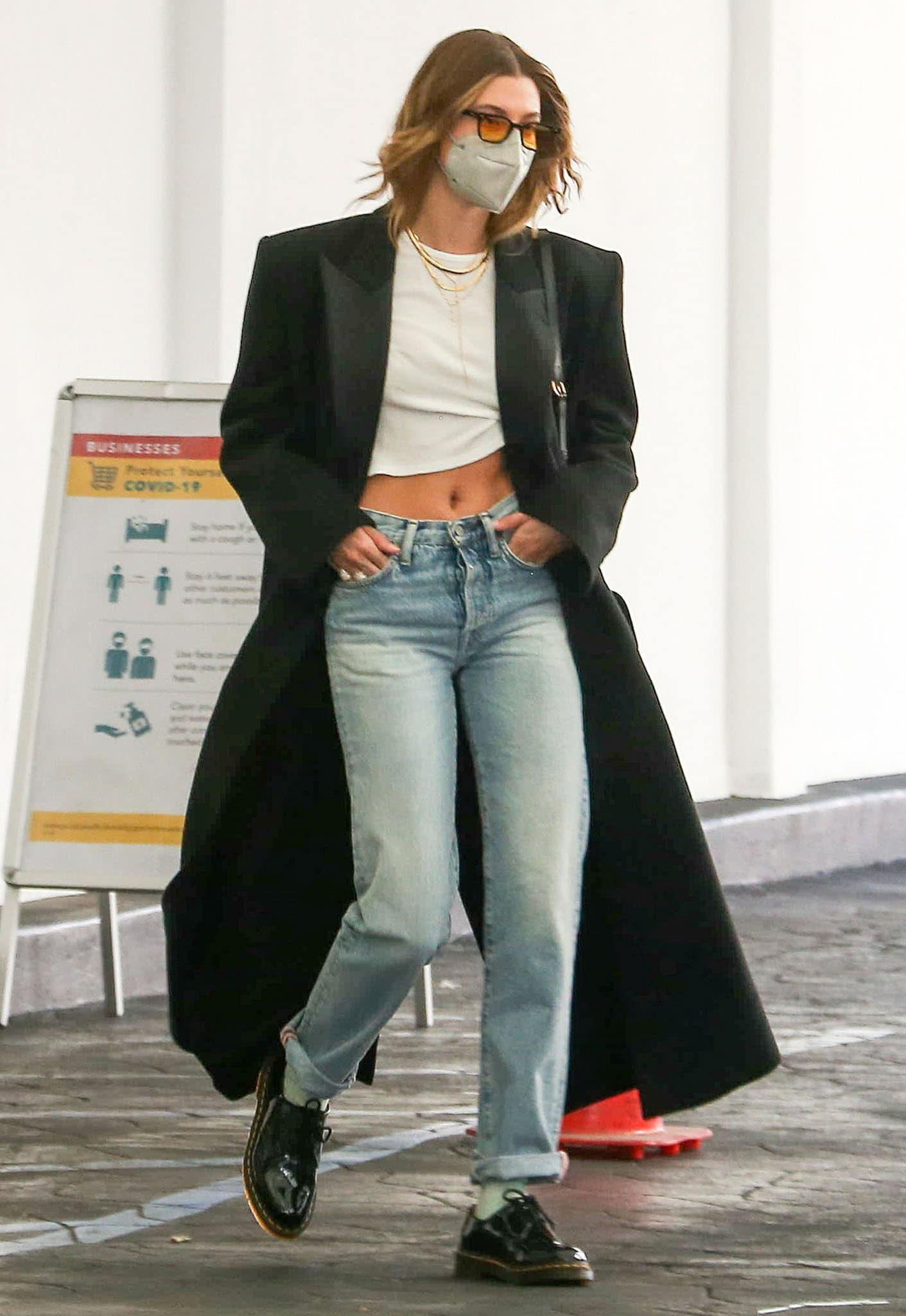 Hailey Bieber in a Magda Butrym coat, Acne jeans, and an Eterne white cropped top