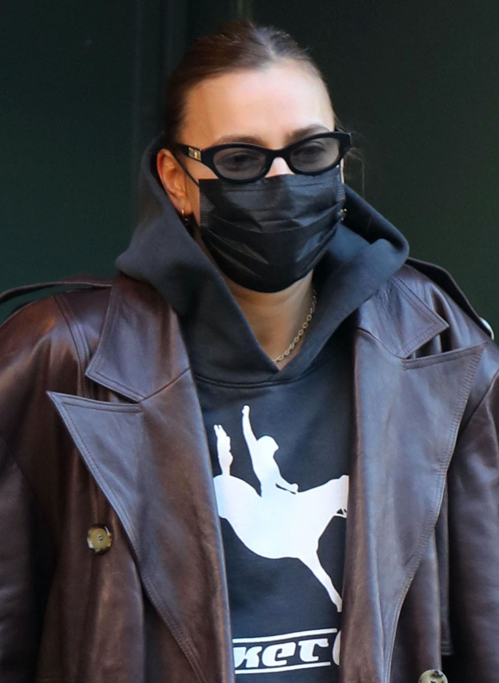 Irina Shayk hides her eyes behind Poppy Lissiman sunglasses and stays safe with a black face mask