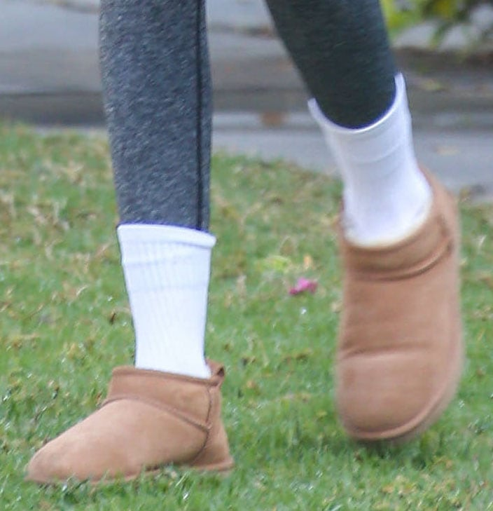 Kaia Gerber teams her Pilates outfit with UGG Classic Ultra Mini boots and white socks
