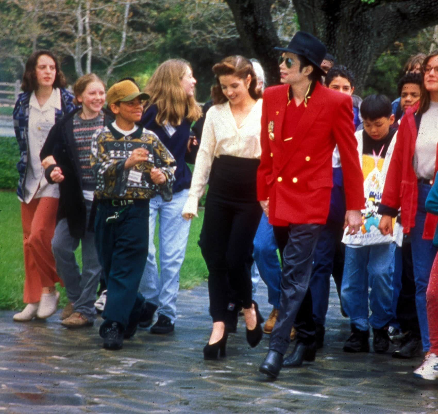 Lisa Marie Presley and Michael Jackson at Neverland Ranch during a VIP visit by a group of children