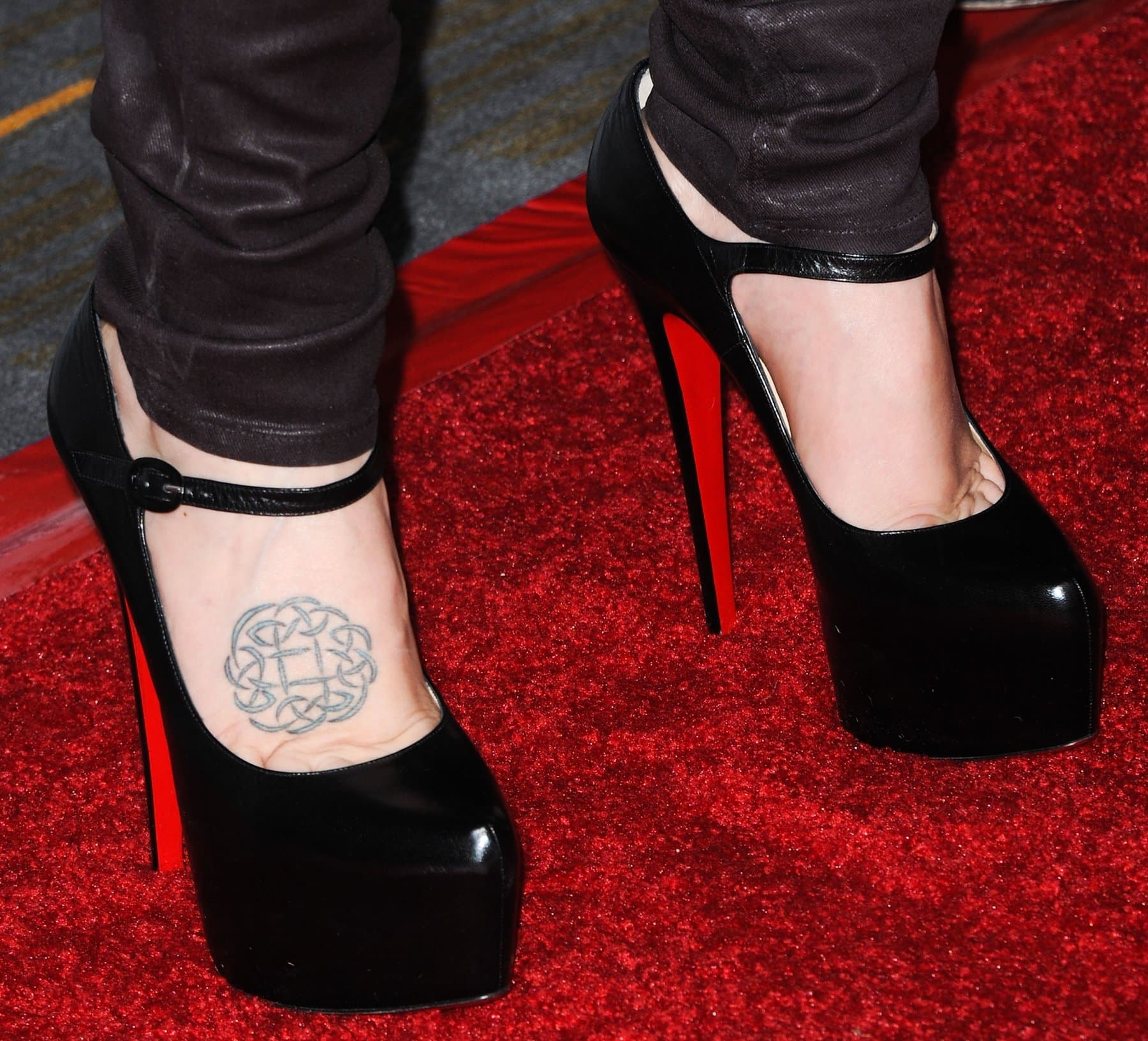 Lisa Marie Presley shows off her Celtic eternity knot foot tattoo in Christian Louboutin heels
