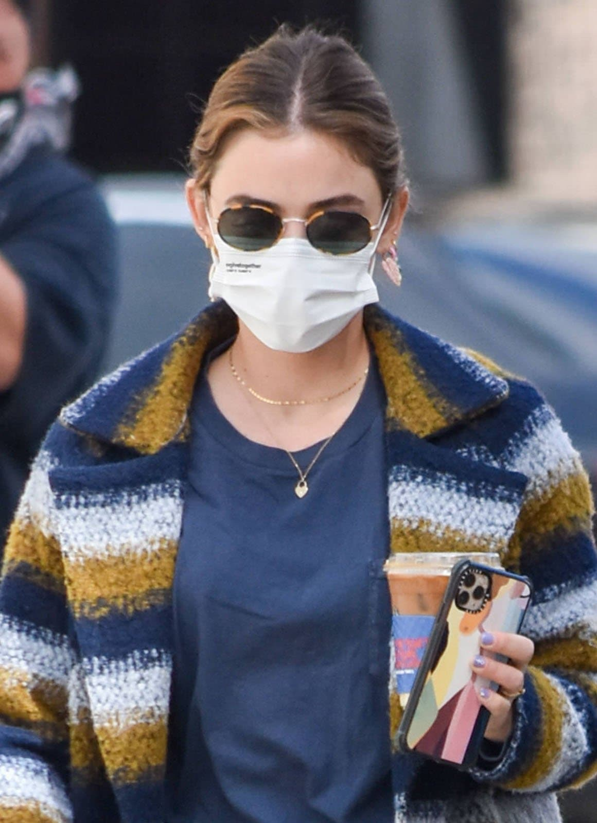 Lucy Hale accessorizes with Uncommon James earrings and stays safe with EvolveTogether face mask