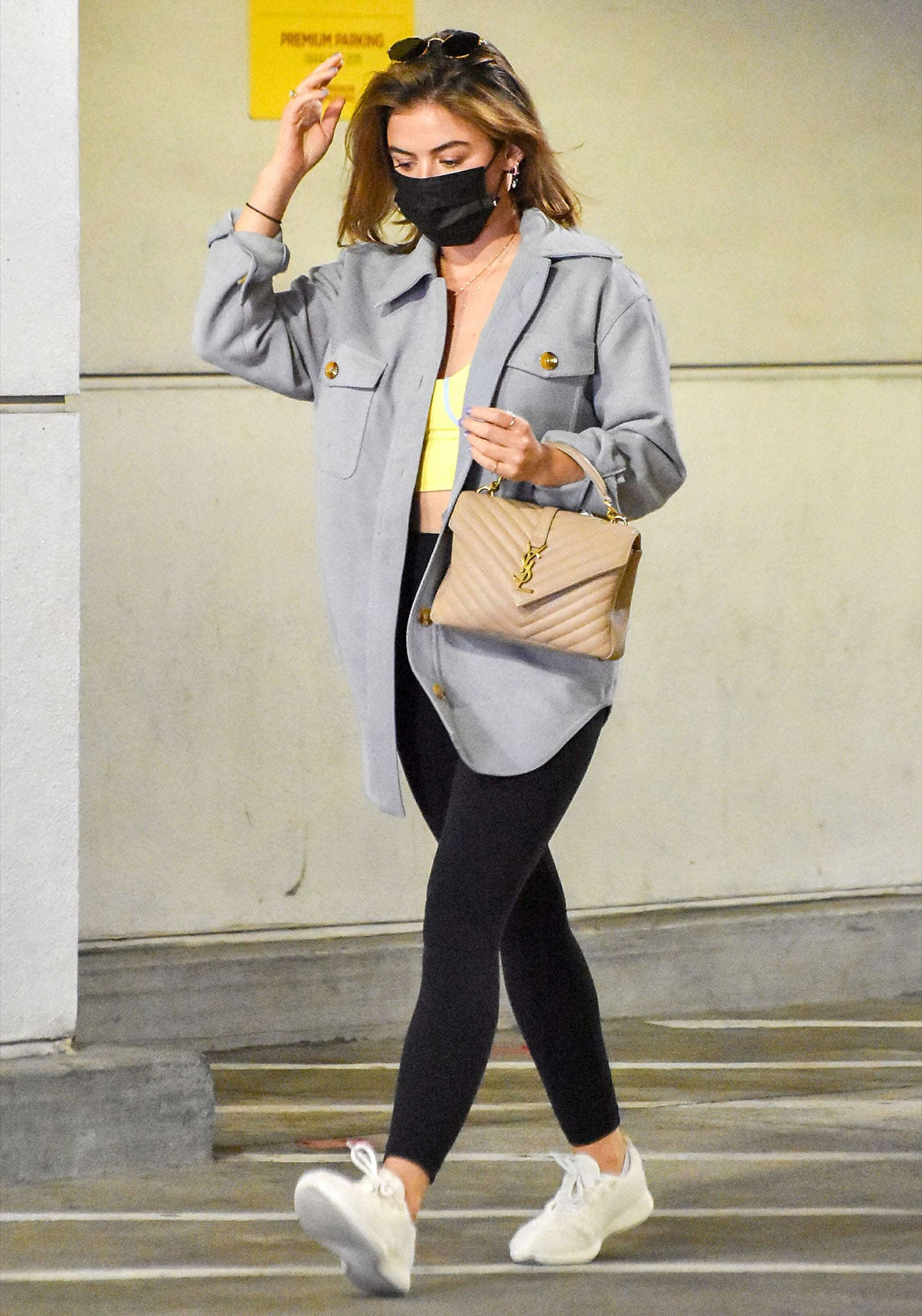 Lucy Hale shops at Target in Fabletics x Madelain sports bra, leggings, and Good American shacket on March 9, 2021