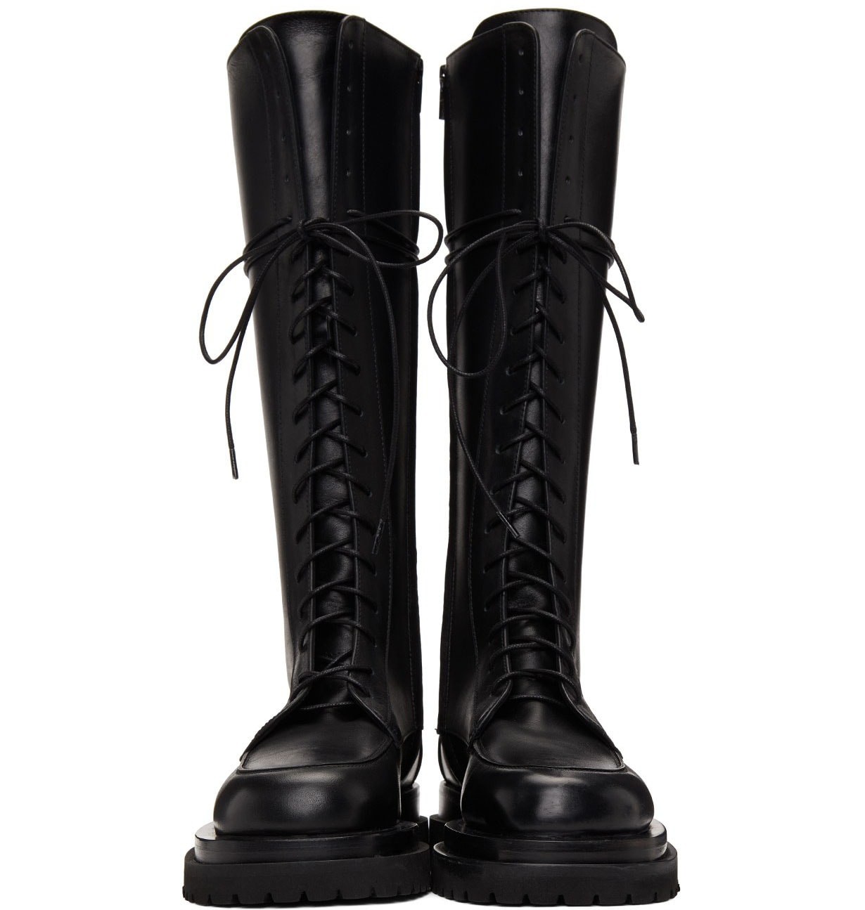 The Magda Butrym combat boots feature a lace-up fastening with ridged rubber platforms and heels