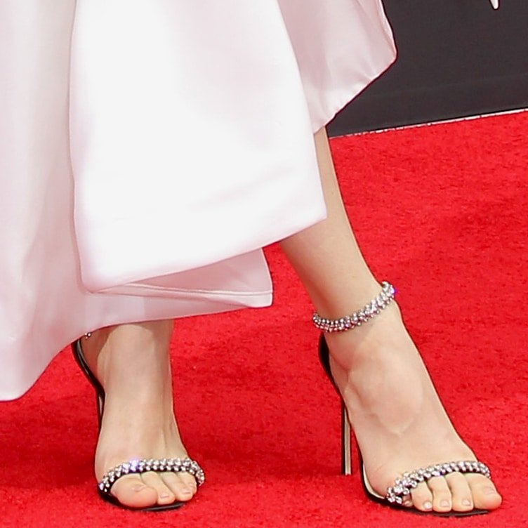 Maude Apatow shows off her size 9 (US) feet in glittering high heel sandals