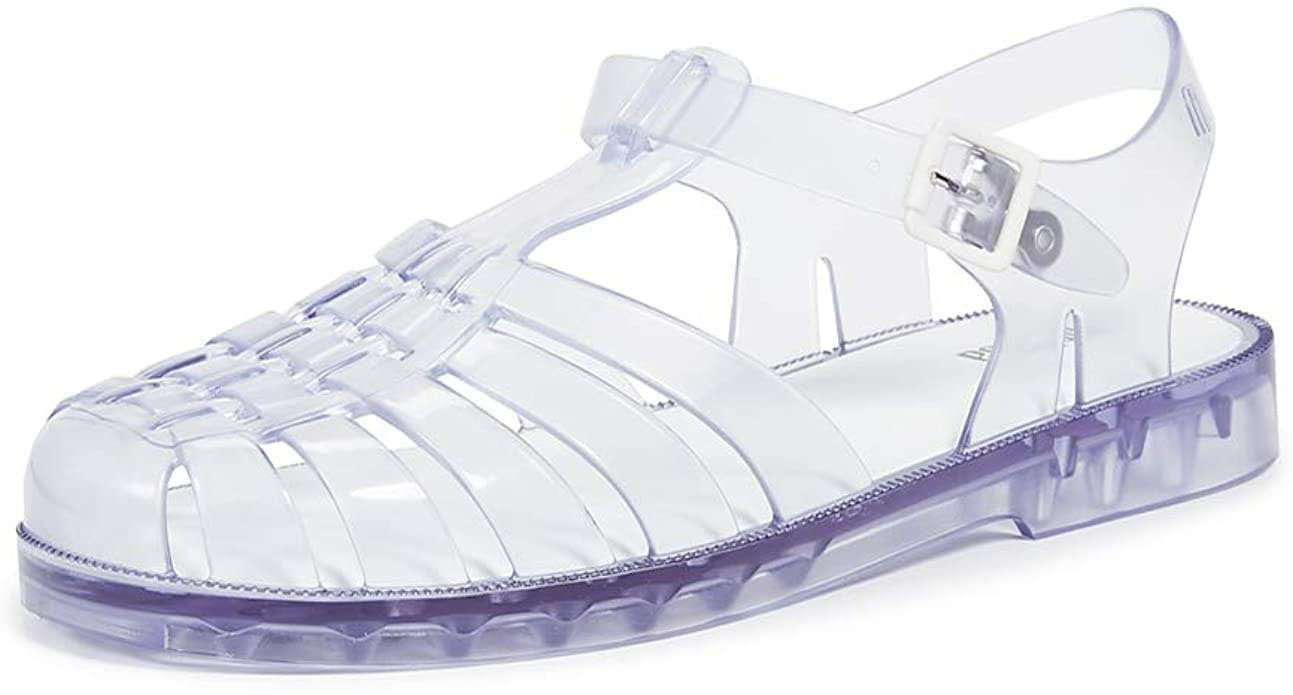 The Melissa Possession is a classic '90s clear jelly shoe with rounded cage toes and ankle straps