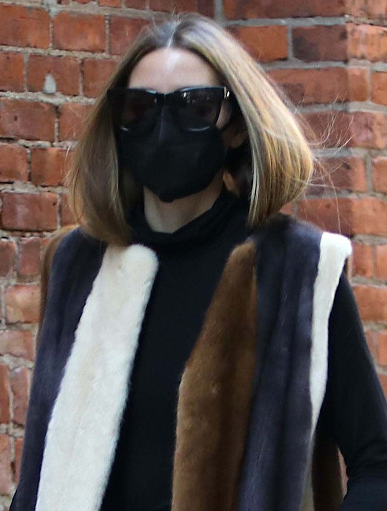 Olivia Palermo hides her eyes in a pair of Le Specs sunglasses