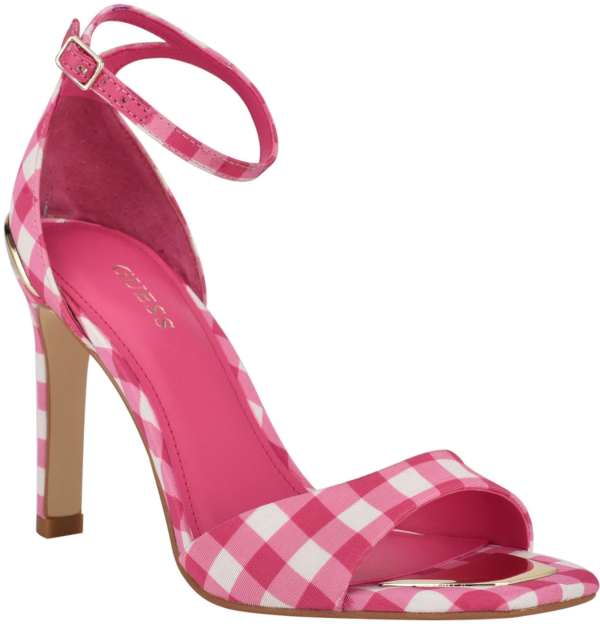 Stroll like a supermodel in this pink gingham dress sandal featuring an appealing logo metal rand and slim covered heel