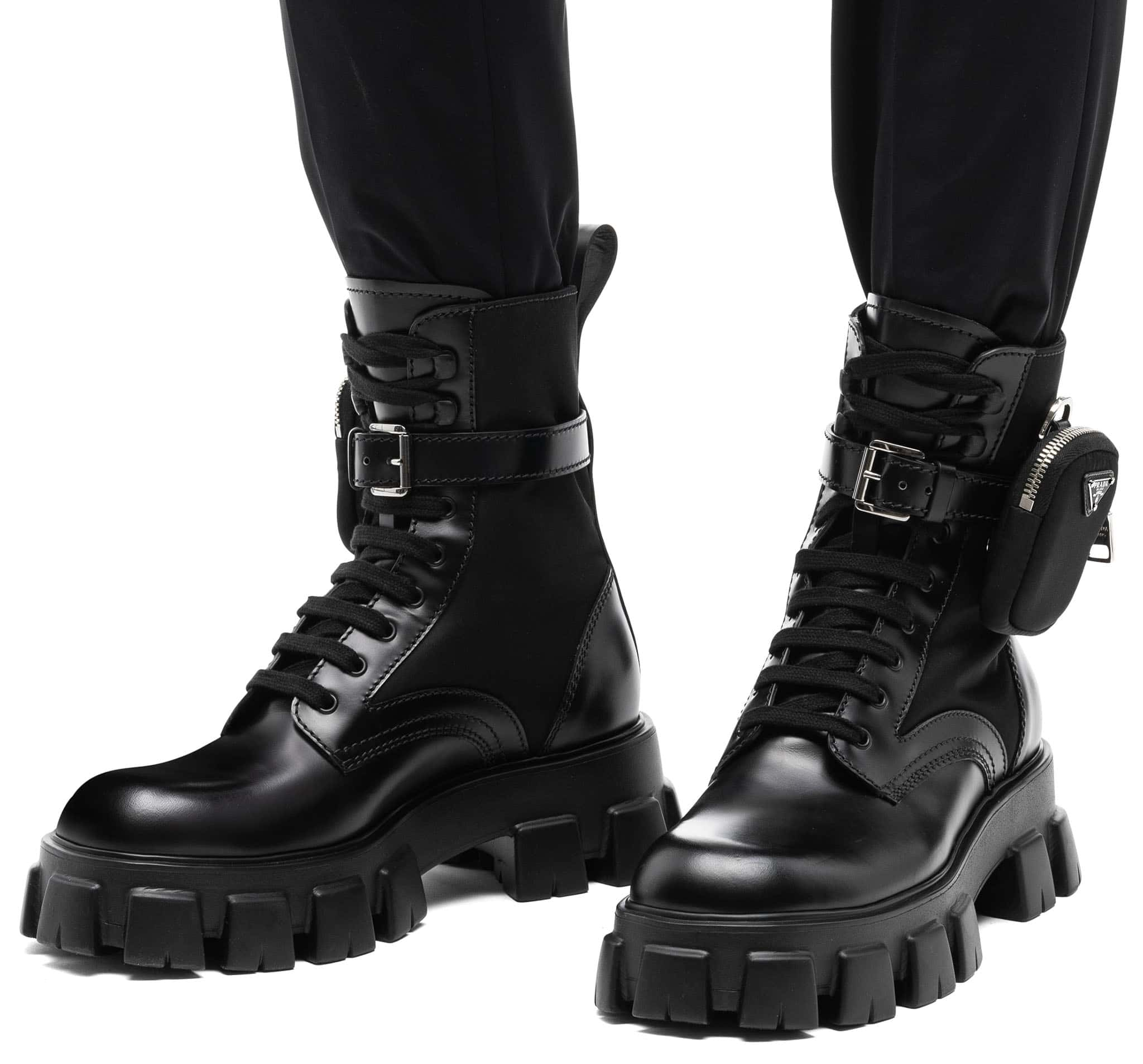 The Prada brushed leather and technical fabric boots are characterized by the removable pouch and have oversized light rubber sawtooth soles