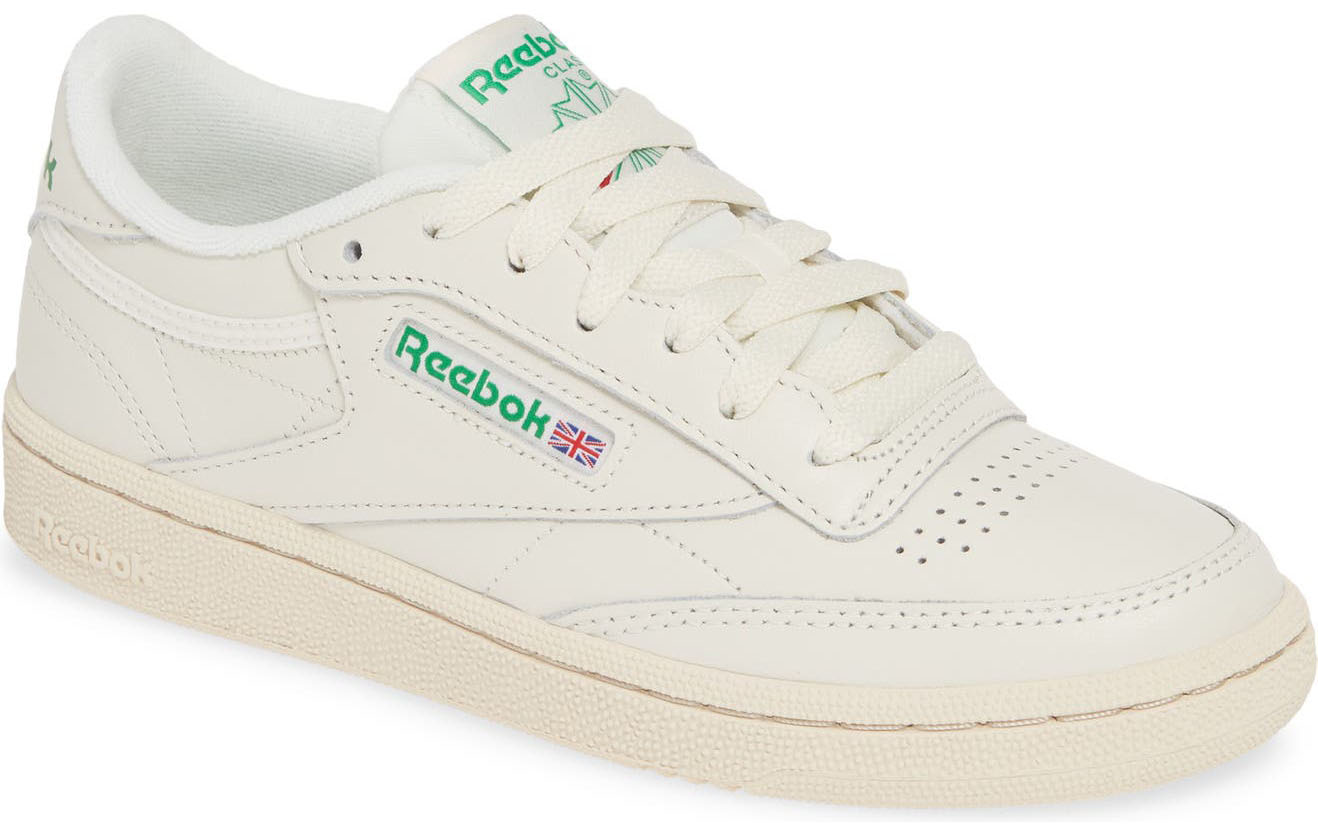 The classic Reebok Club C 85 sneaker features perforations and a pivot-zone construction in the tread