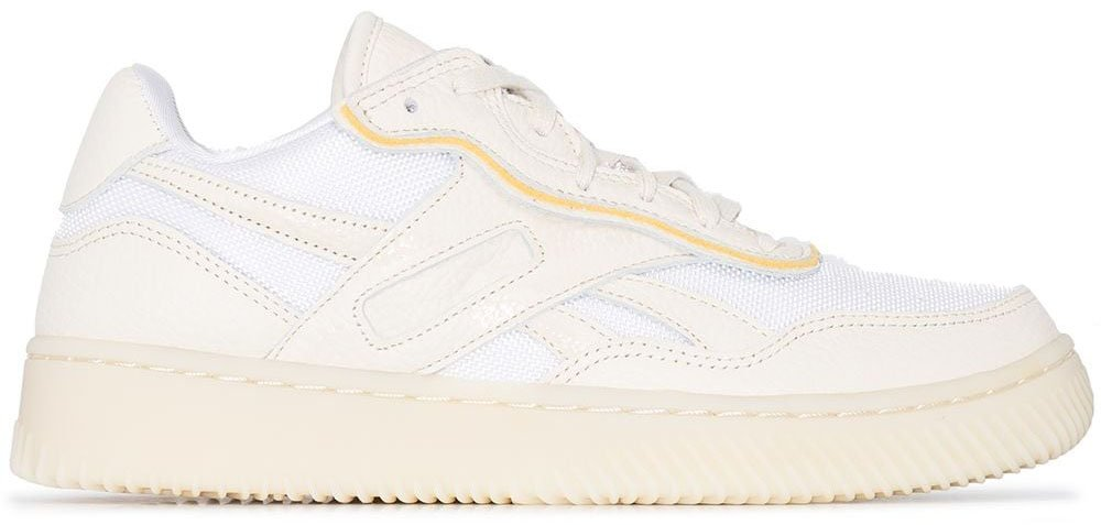 This shoe collaboration between Victoria Beckham and Reebok features a mesh and leather upper with contrasting yellow piping
