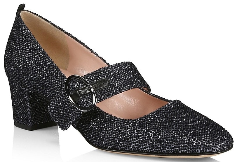 Made from glitter fabric, the Tartt Mary Jane pumps feature a wide buckled strap with almond toes and short block heels