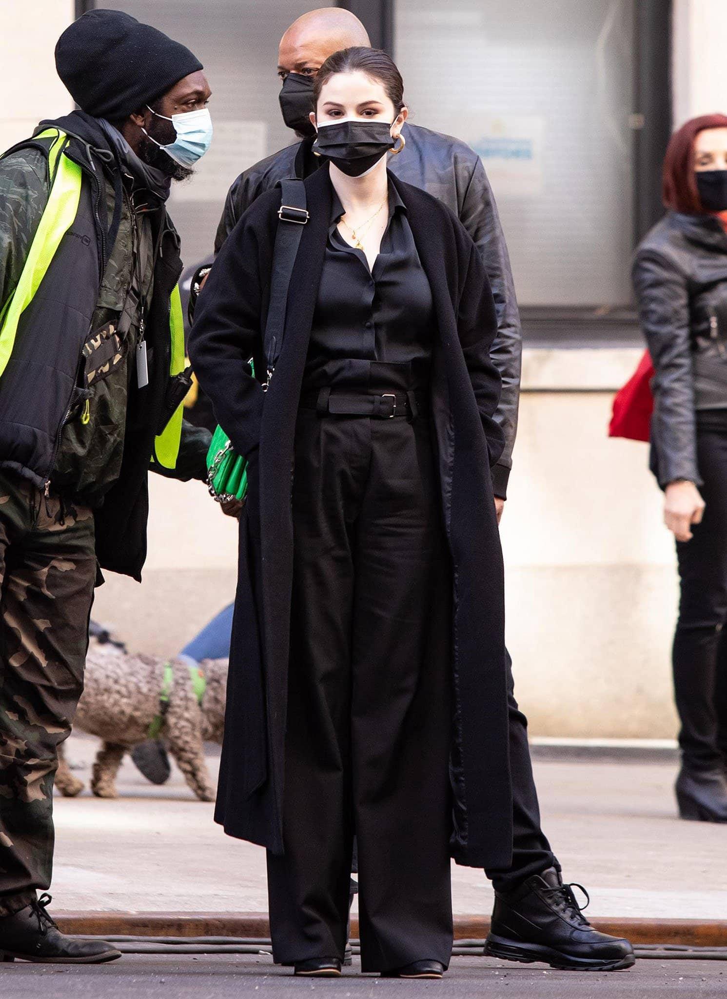 Selena Gomez carries a green Louis Vuitton Coussin PM crossbody bag
