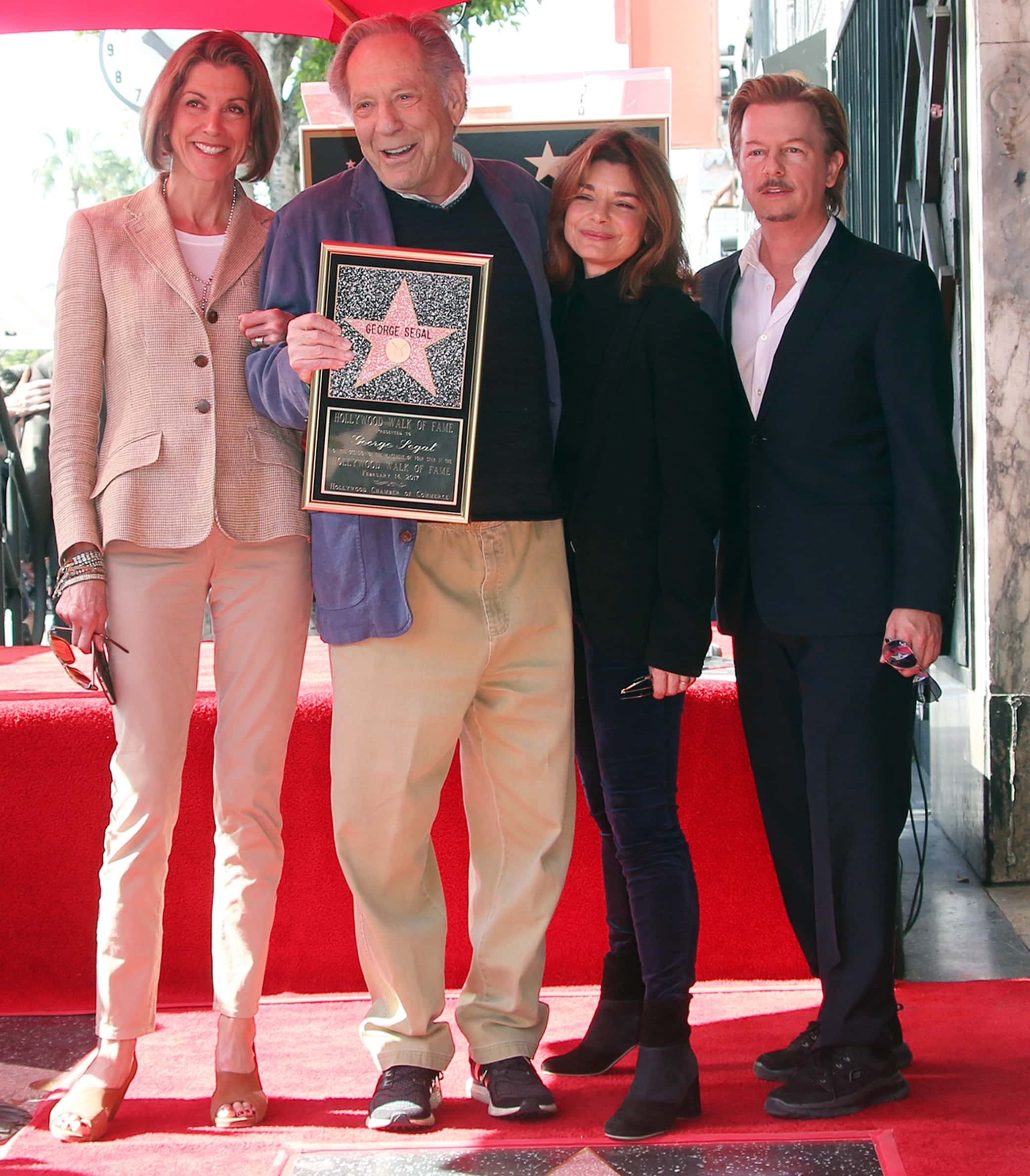 Actors Wendie Malick, George Segal, Laura San Giacomo, and David Spade attend George Segal being honored with a Star on the Hollywood Walk of Fame