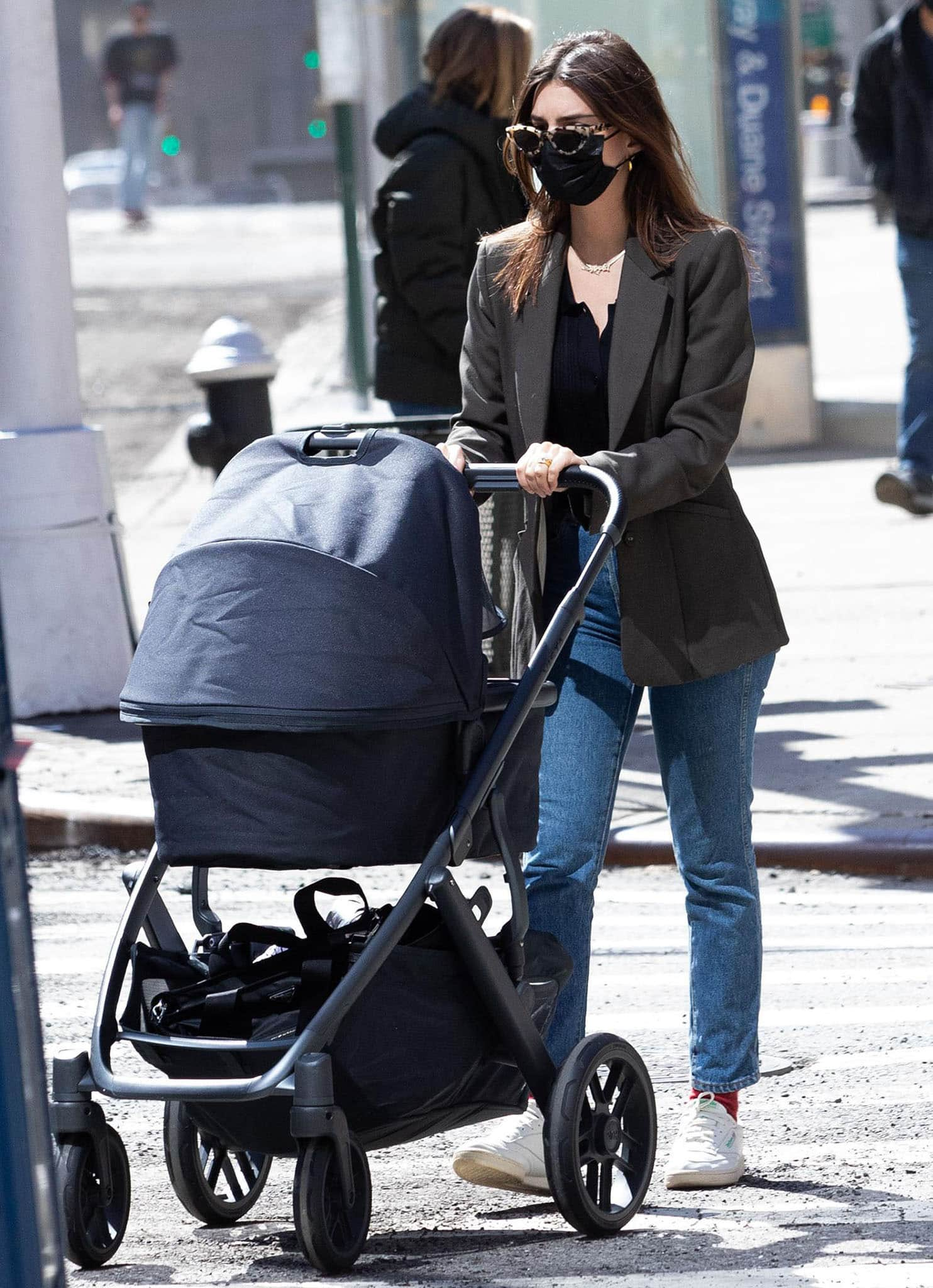 New mom Emily Ratajkowski pushes her newborn son in Uppababy stroller