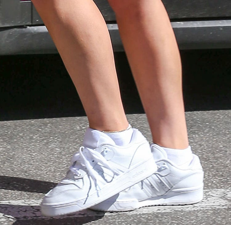 Addison Rae teams her casual outfit with Adidas Hoops 2.0 sneakers