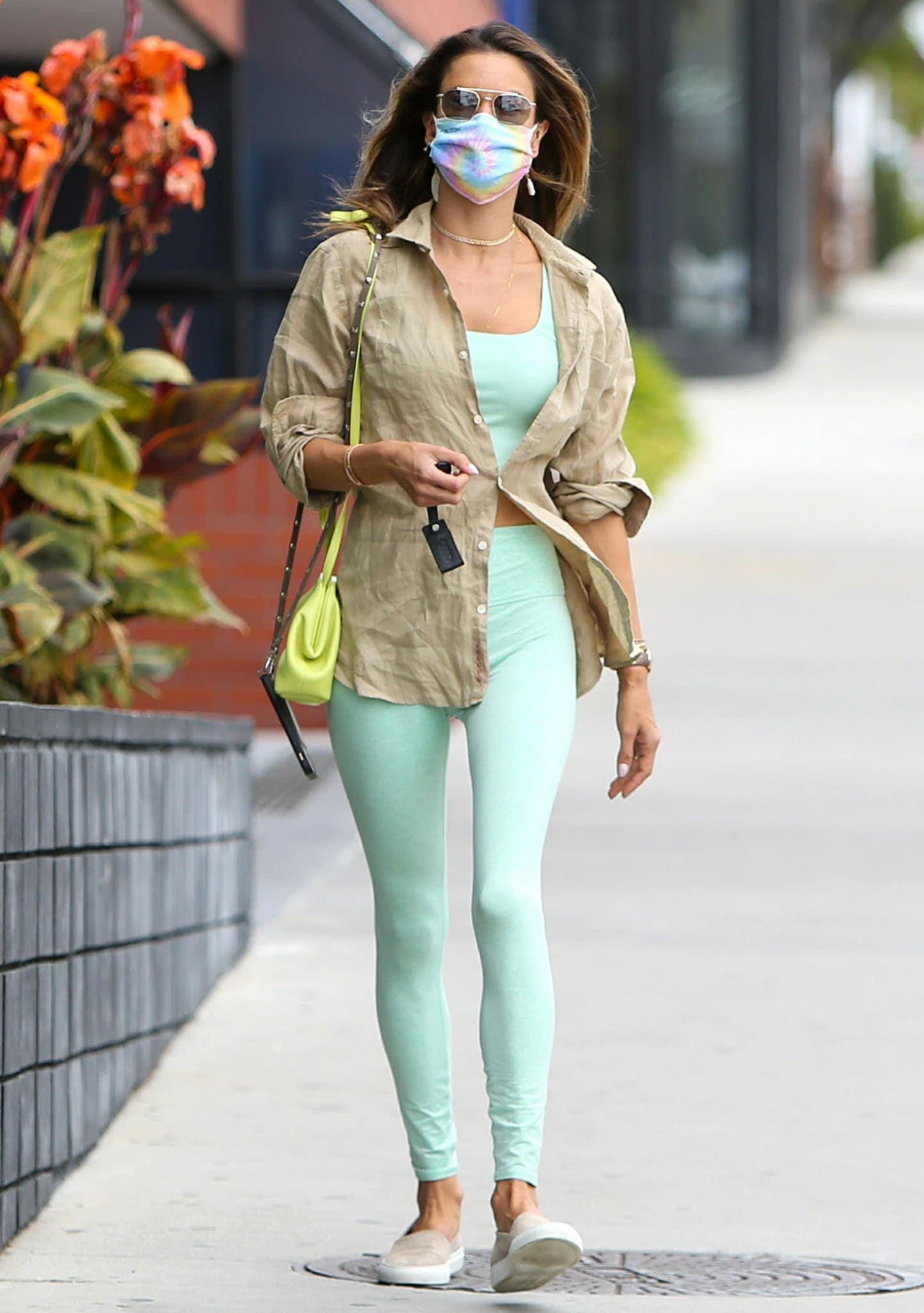 Alessandra Ambrosio steps out for Pilates class in Alo Yoga honeydew heather bra top and leggings on April 1, 2021