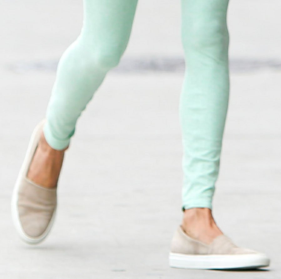 Alessandra Ambrosio matches her linen shirt with her neutral-toned Common Projects slip-on sneakers