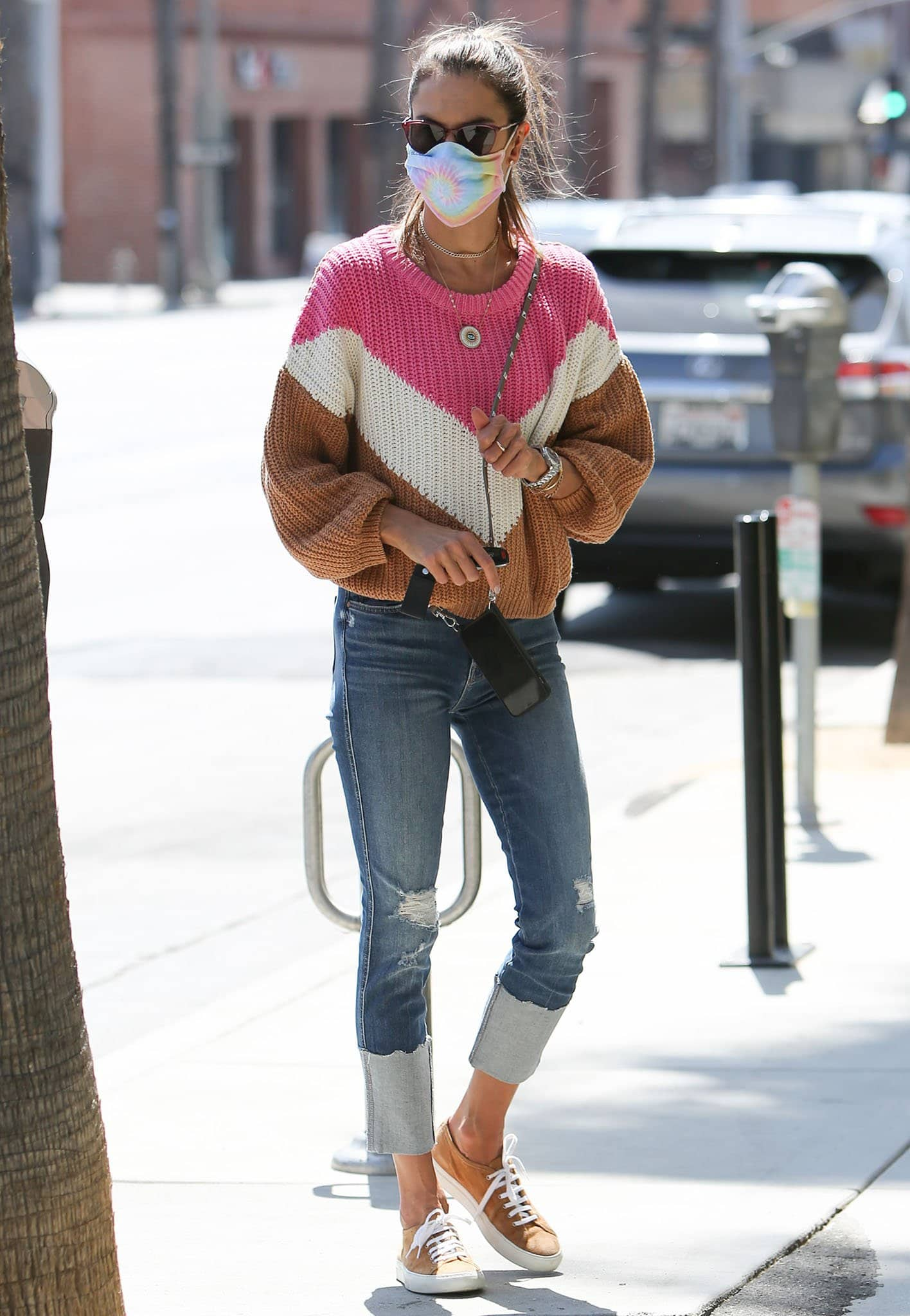 Alessandra Ambrosio steps out in Francesca's chevron color-block sweater and Mother The Pony Boy Chew jeans on April 2, 2021