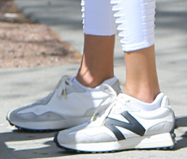 Alessandra Ambrosio completes her workout outfit with New Balance x Casablanca 327 black and white shoes