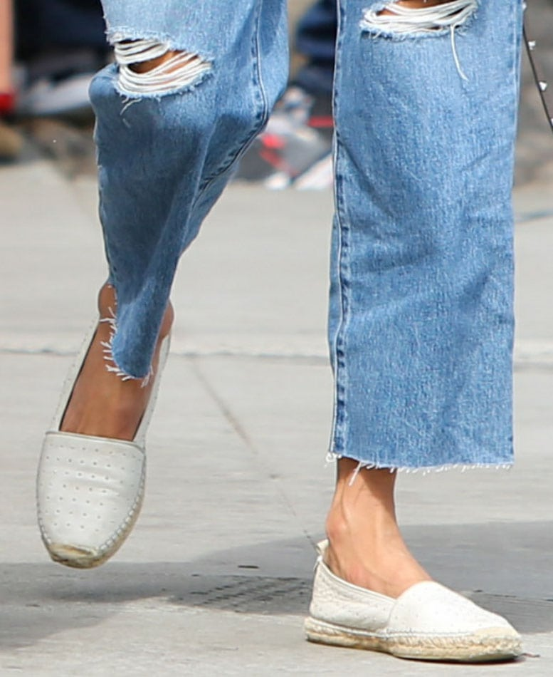 Alessandra Ambrosio completes a chic casual outfit with Saint Laurent white studded espadrilles