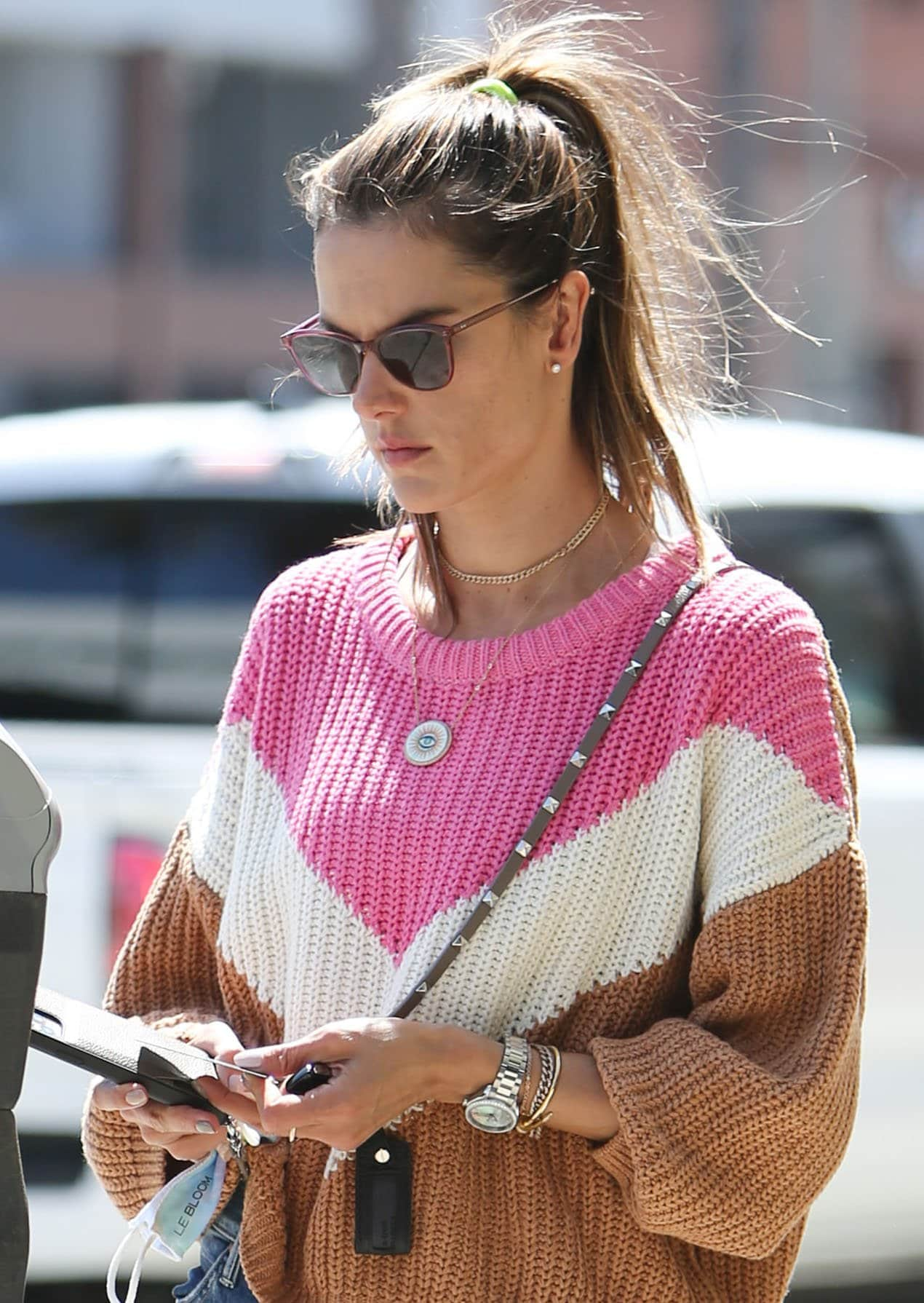 Alessandra Ambrosio wears barely-there makeup and a messy high ponytail