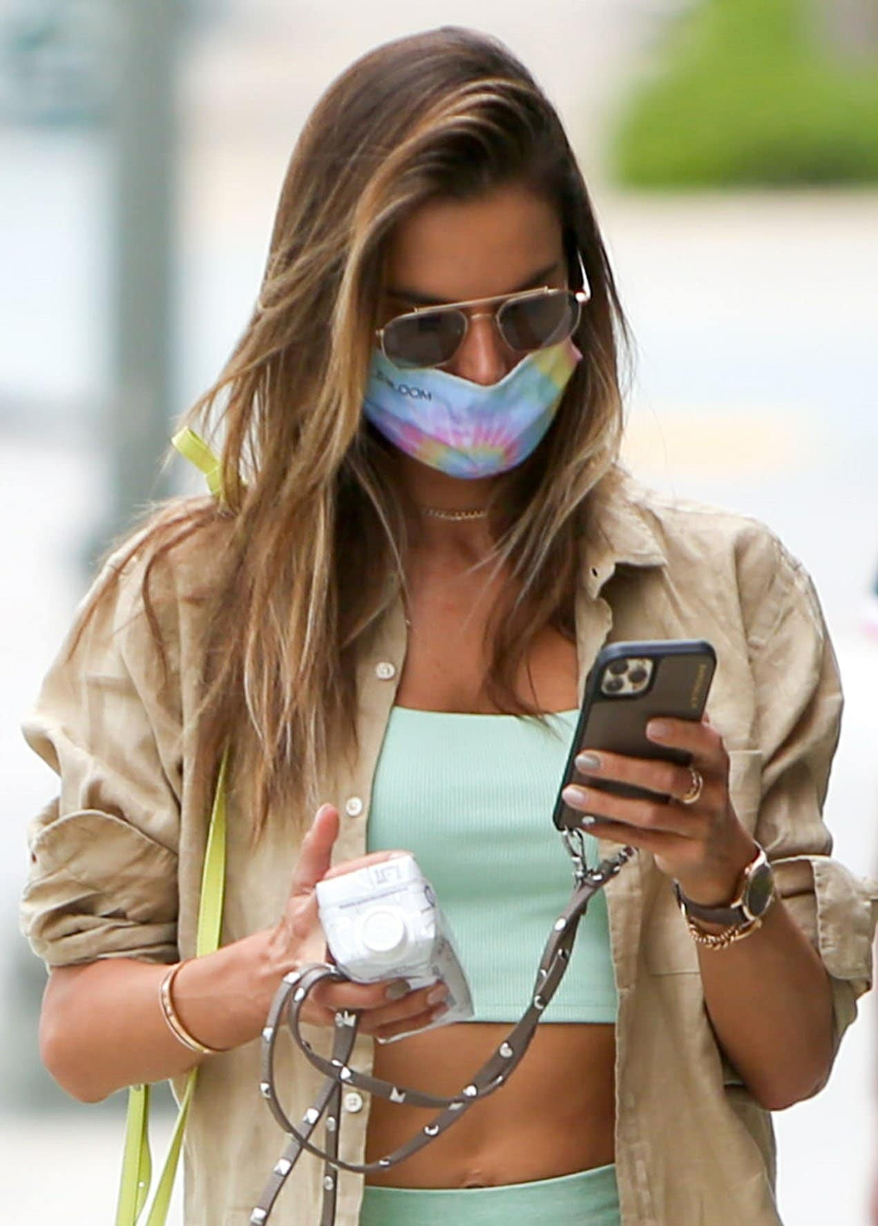 Alessandra Ambrosio stays safe from COVID-19 with a tie-dye rainbow face mask