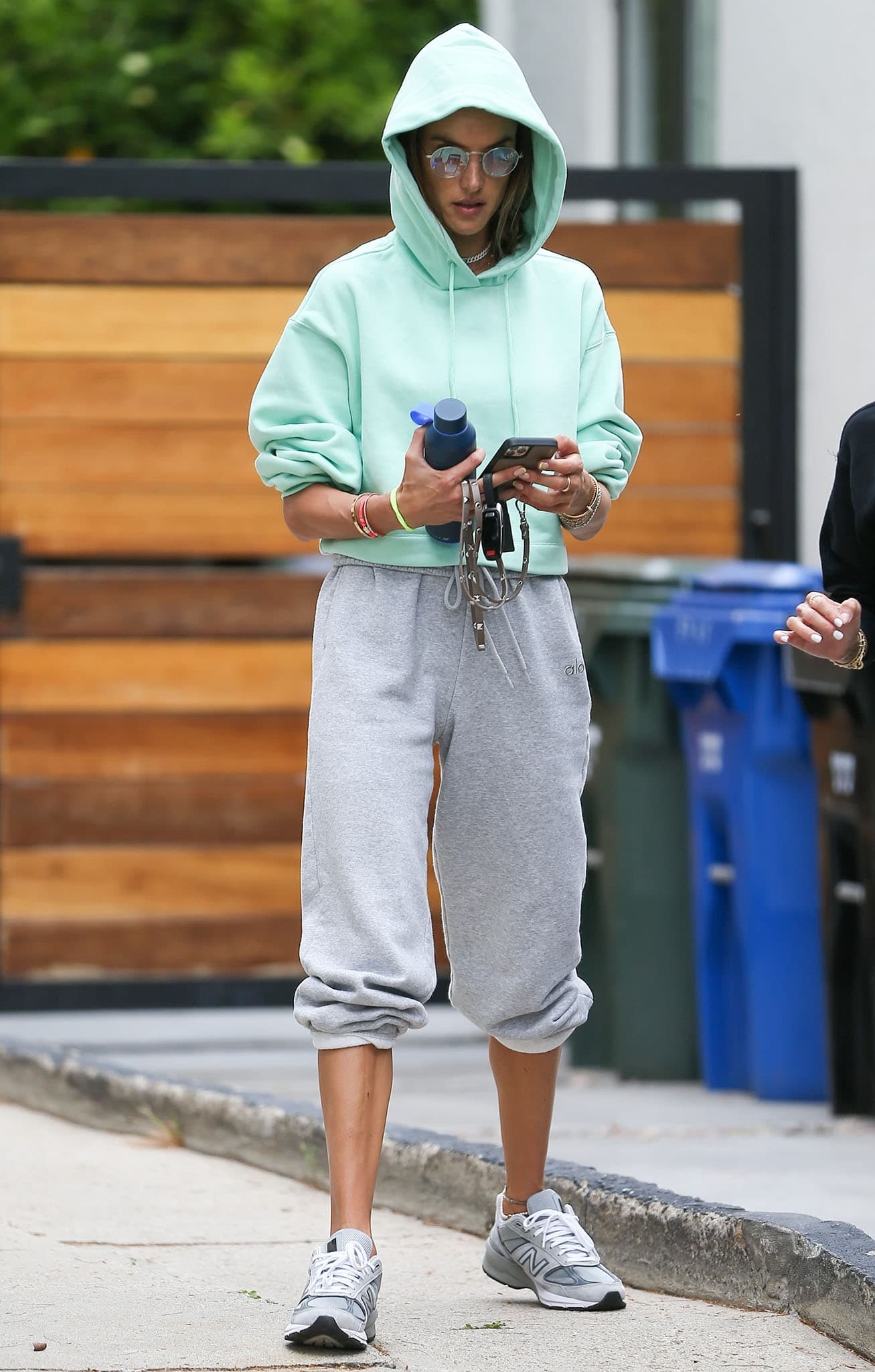 Alessandra Ambrosio goes to Pilates in a mint green hoodie with gray leggings on April 13, 2021