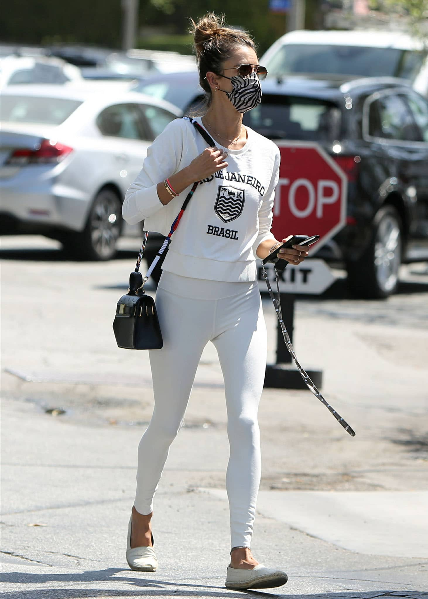 Alessandra Ambrosio heads to gym in white Brasil sweater and white leggings on April 15, 2021