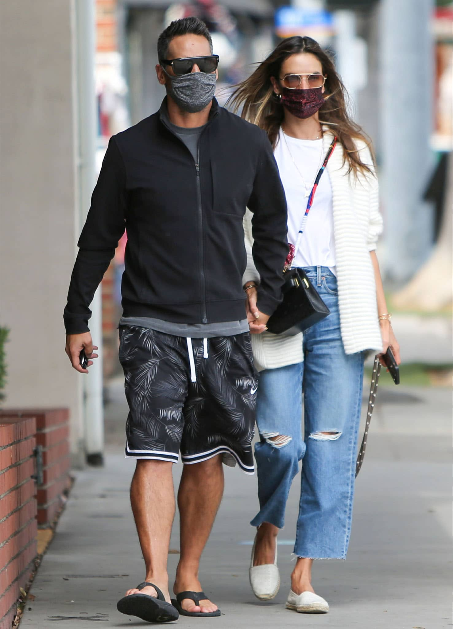 Richard Lee and girlfriend Alessandra Ambrosio hold hands while on a stroll in Los Angeles on April 21, 2021