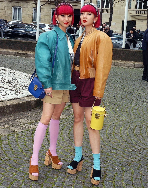 Twin sisters Ami Suzuki and Aya Suzuki attend the Miu Miu show