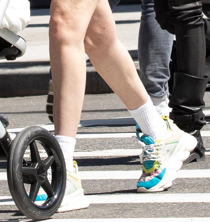 Gigi Hadid teams her sporty wear with high-end chunky sneakers from Versace
